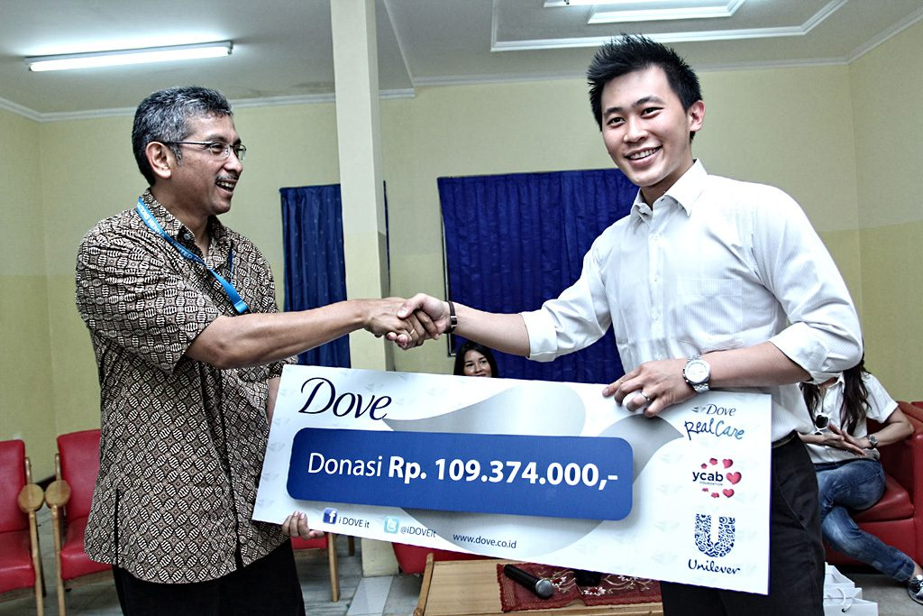 Symbolized Donation from Dove to YCAB